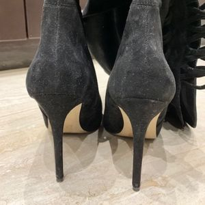 Black suede over the knee stiletto boot
